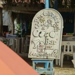 Sign propped up under the palapa roof