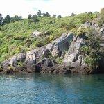 Maori rock carvings on the lake shore