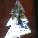 Snowman-building fun (taken through the front-porch railing.