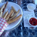 We had already eaten a few fries before this was taken. This is a regular order. Huge!
