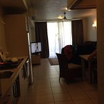 Kitchenette to the left, study to the right, lounge/TV area ahead.