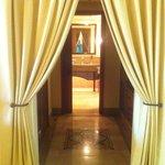Corridor to walk-in closet, kitchenette and bathroom