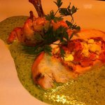 Ovenroasted supreme of chicken stuffed with feta cheese  butternut squash on  pesto cream sauce.