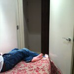 Door to room cannot close as bed in way; room size of bed!