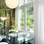 dining room with balcony and garden view