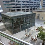 Had private Balcony which overlooked a Plaza with offices on our level and shops/restaurants bel