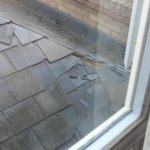 Broken tiles on the hotel roof
