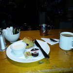 Coffee and a scone with whipped cream. Yummy.