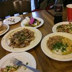 """One plate of Humus """"triple"""" (with Beans and Ful) and one plate of Humus with chicken and onions"""
