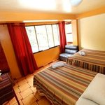 Double room with king size bed and single bed.