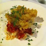 One of our favourite entrées - Crispy calamari on a bed of rice and fragrant tomato sauce
