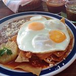 verde and rojo chile sauce with huevos and frijoles - muy bueno.