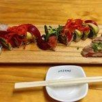 Assorted rolls and sashimi