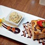 Ptarmigan Signature Dessert, bananna bread pudding with housemade pistachio gelato