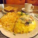 Vegetable omelet, potatoes, coffee, toast.