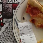 Our pizza slice and the roach it harbored, 12/1/2013.