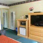 Room 106 closet, flatscreen TV, microwave, refrigerator