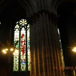 Juxtaposition of beautiful stain glass to regular windows of those lost to war