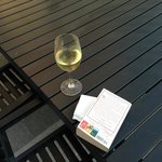 Sit down to relax with my book and my wine.