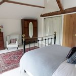 Kilvert Suite bedroom showing door to living area