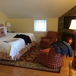 Sweet William room. Great size bed with extra seating area and fire place. The bed sheets are am