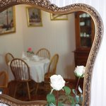 Breakfast table reflection in the mirror