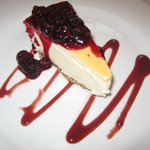 Vanilla Cheesecake with berries and coulis
