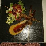 Kebabs of fillet steak satay with sauces of peanut and sweet chilli.