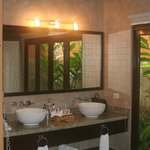Great full bathroom with an outdoor shower.