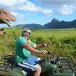 Ride through Jurassic Park, but watch out for dinosaurs.