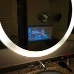 TV in mirror in bathroom