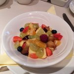 Tasty breakfast with fruit salad.