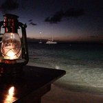 Lantern lit table on the beach.