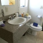 granite sinktop with toilet blocking door