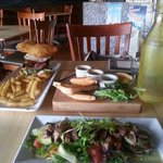 A view of my towering fried bread burger and my friends delicious salad :-P