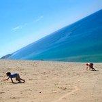people climbing the huge sand dune