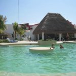 Fun at the pool bar with music, dancing, water aerobics, sun all day! Great service too.