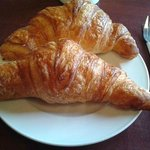 Massive house made croissants with a crisp buttery exterior and tightly wound soft interior. ($2