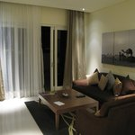 The living room of the suite with access to the terrace