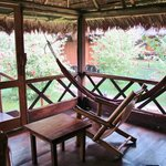 hammock in front of cabana- notice windows- all open air