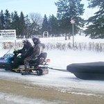 Snowmobile arriving at Bridgevidew Bed & Breakfast