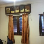 The window in the quad room..facing road side and Masjid