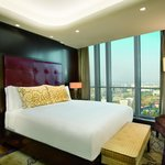 Our Executive Suite bedroom looks out onto the heart of the city. (85680105)