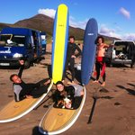 getting ready for a surf on a lovely sunny summers day