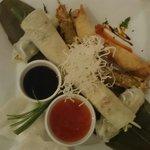 Starter for two People. Thai springrolls, vietnamese springrolls, chicken in satay and pancakes