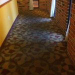 More dirty carpet on path from bar/dining area to lobby