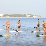 Paddling out after a session of Yoga Sup
