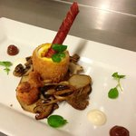 Deep Fried Duck Egg coated in Breadcrumbs served on a Crispy Fried Crouton with Wild Mushrooms,