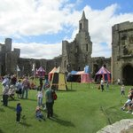 Archery ,jousting and other knightly skills being taught.