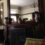 The front parlor is full of antiques and artwork